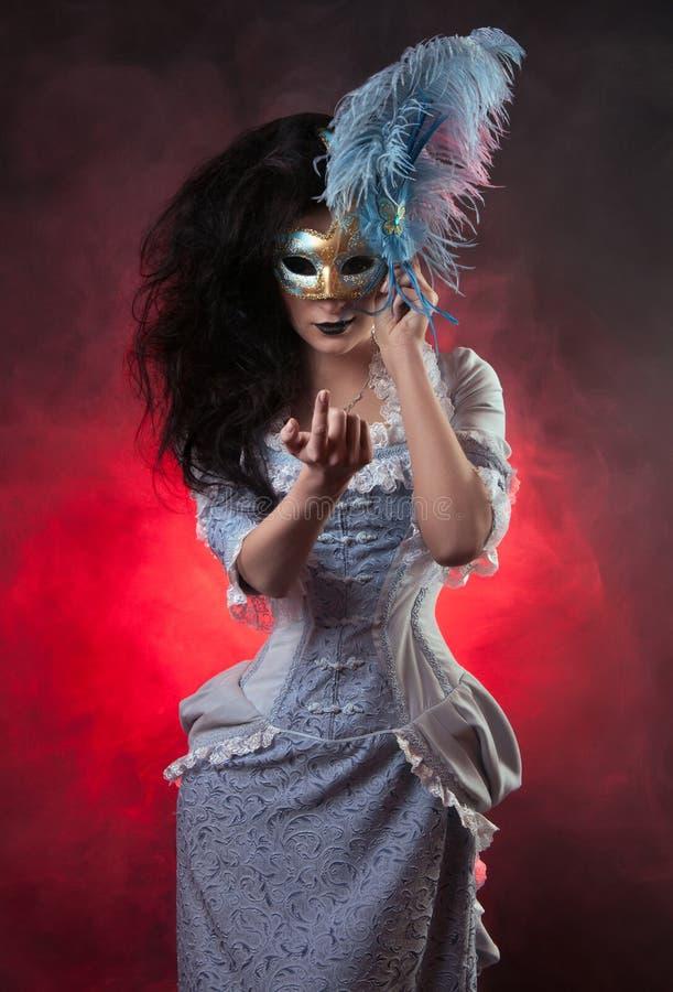 Halloween vampire woman with venetian mask. Beautiful Halloween vampire woman aristocrat with venetian mask royalty free stock photo