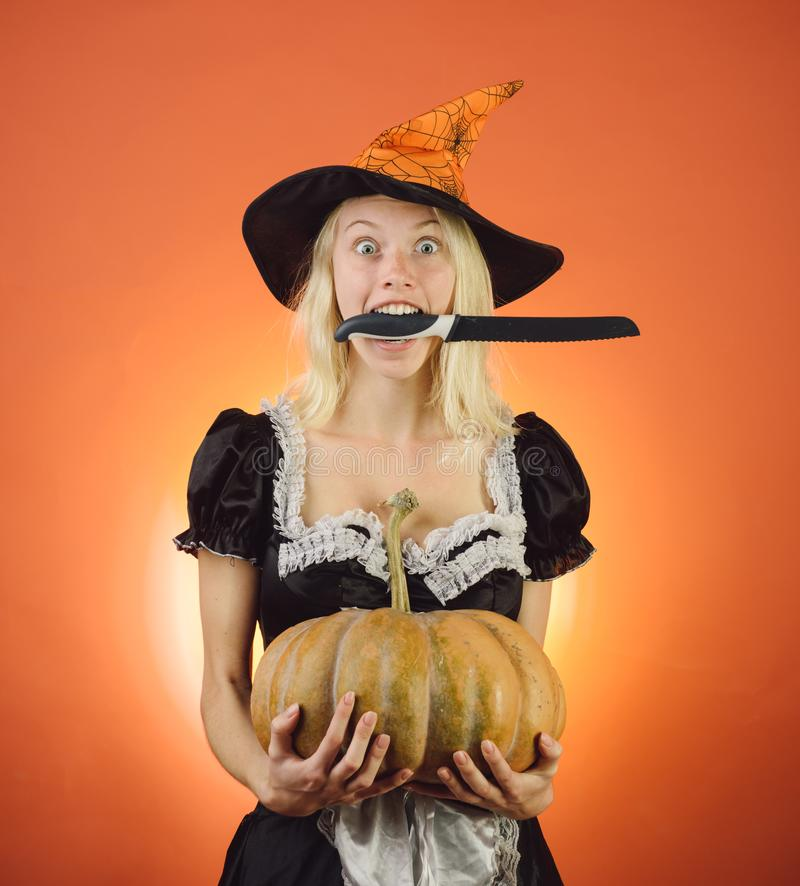 Halloween wide banner with housekeeper. Blonde housewife with pumkin play and posing. Surprised woman in witches hat and stock photos