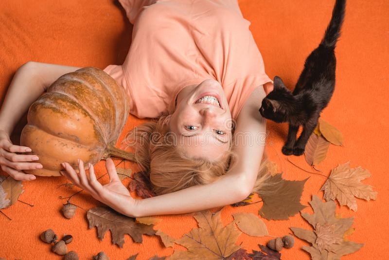 Halloween wide banner with Woman. Witch with Pumpkin and black cat. Halloween wide poster for Happy halloween. Celebrate. Halloween Party girls stock images