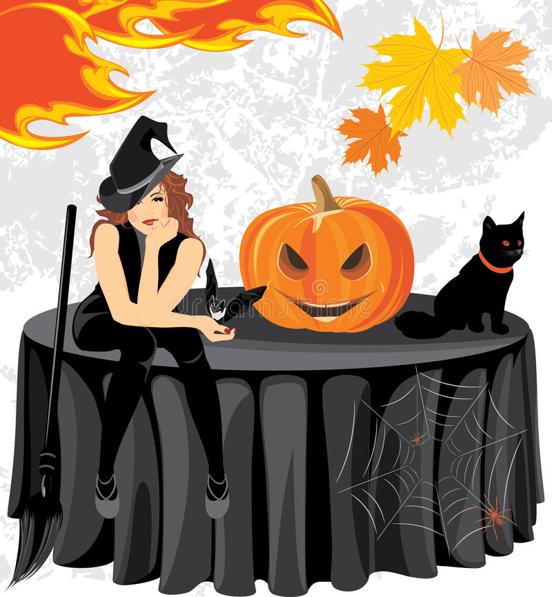 Halloween witch with a bat, cat and pumpkin sitting on the table stock photos