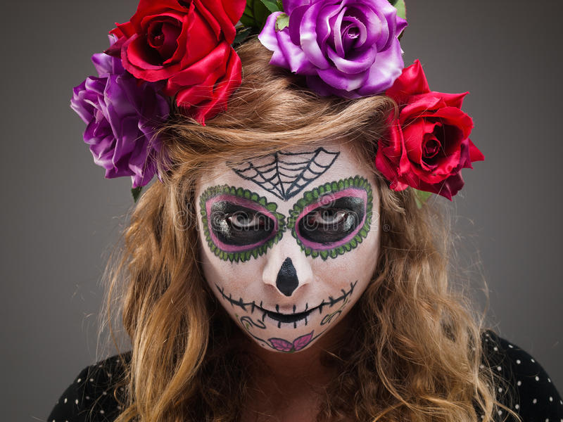 Halloween witch. Beautiful woman wearing santa muerte mask portrait stock image