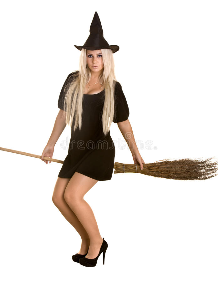 Download Halloween Witch In Black Dress And Hat On Broom. Stock Photo - Image: 10985834