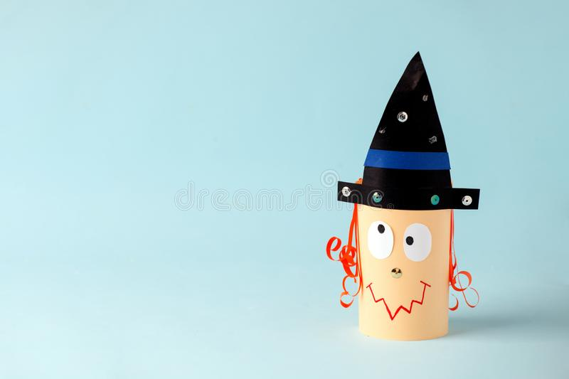 Halloween witch on blue for Halloween concept background. Paper crafts, DIY. Handcraft creative idea fron toilet tube, recycle. Concept, copy space stock photos