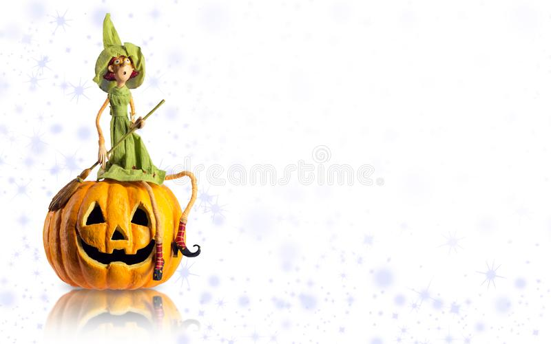 Halloween Witch and carved Pumpkin with magic lights. Copy space mock up royalty free stock images
