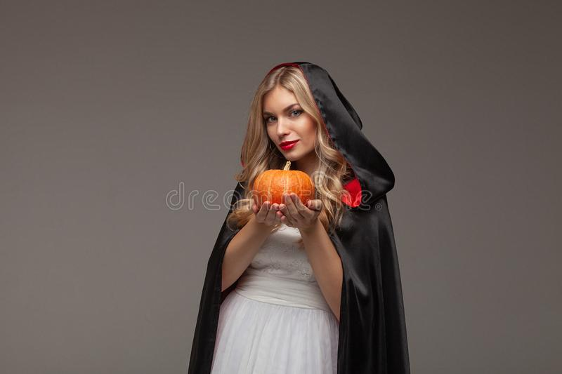 Halloween Witch with a carved Pumpkin Halloween party art design stock image