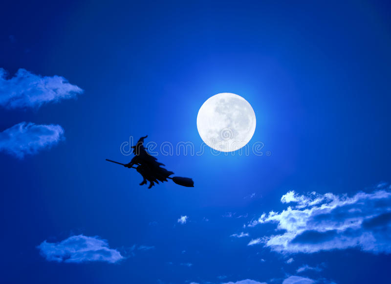 Halloween Witch Flying On Broomstick. A Halloween witch flying on a broom in a full moon sky royalty free stock images