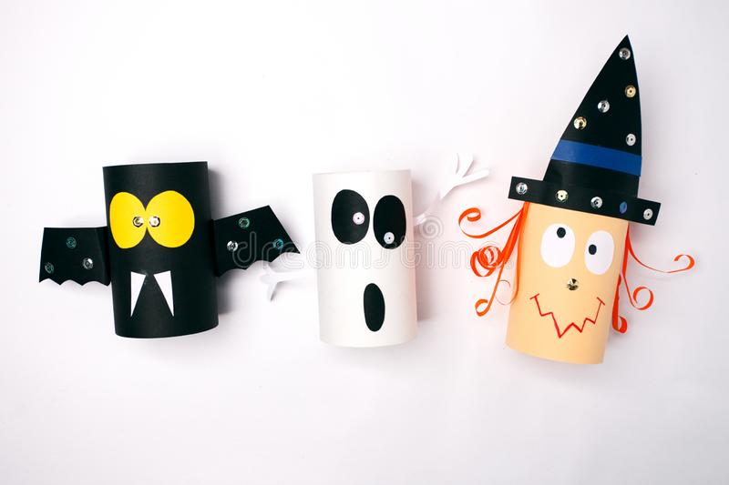 Halloween witch, ghost, bat from paper on white background.Creative DIY for kids. Home decor idea for party stock photography