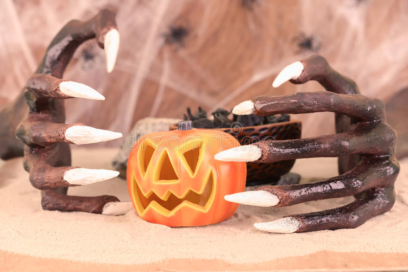 Halloween witch hands and pumpkin ornament stock image