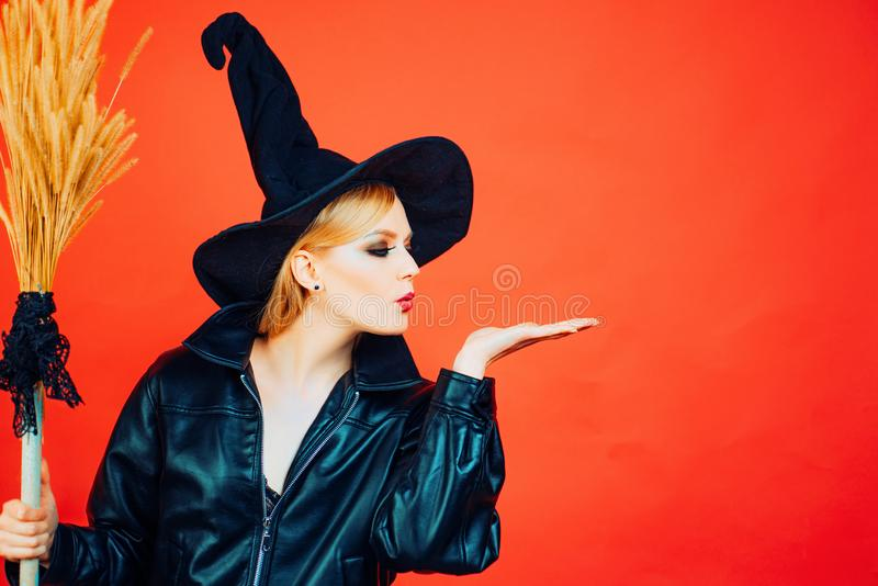 Halloween Witch holding broom or broomstick. appy gothic young woman in witch halloween costume. Halloween concept. Copy. Space royalty free stock image