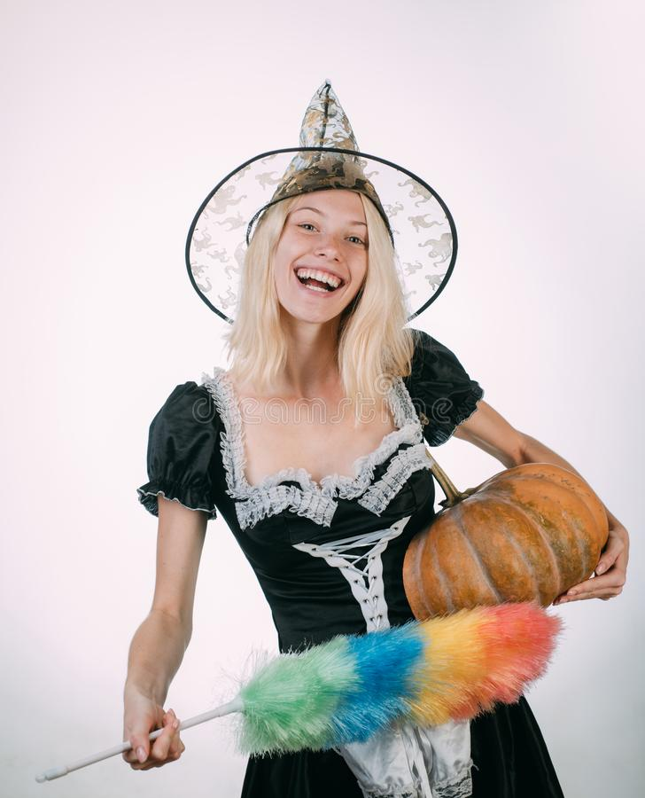 Halloween Witch with pumpkin. Wide Halloween party art design. Surprised woman in witches hat and costume on white royalty free stock images