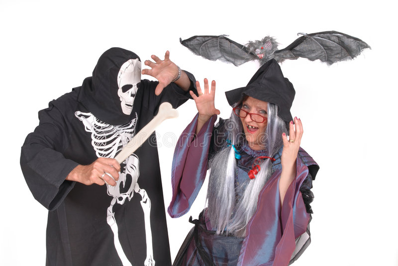 Halloween witch and skeleton stock images