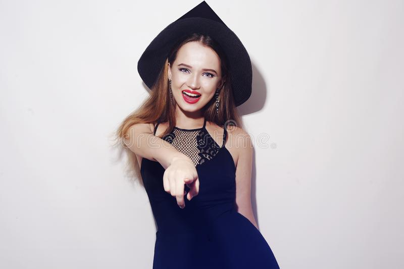 Halloween Witch on white background. Halloween Party girl. Happy Halloween Witch smile. Beautiful young surprised woman in witches royalty free stock photo