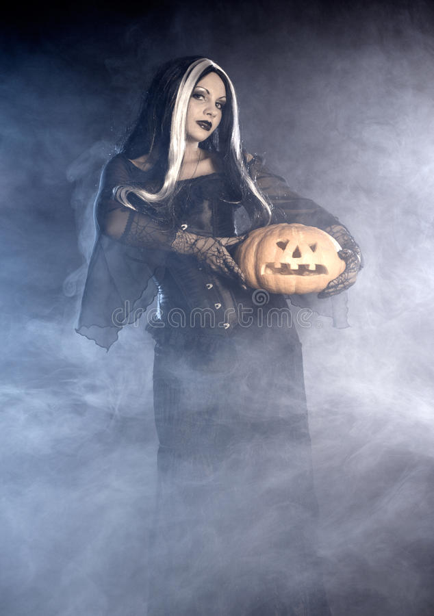 Free Halloween Witch With A Pumpkin. Stock Images - 16589854