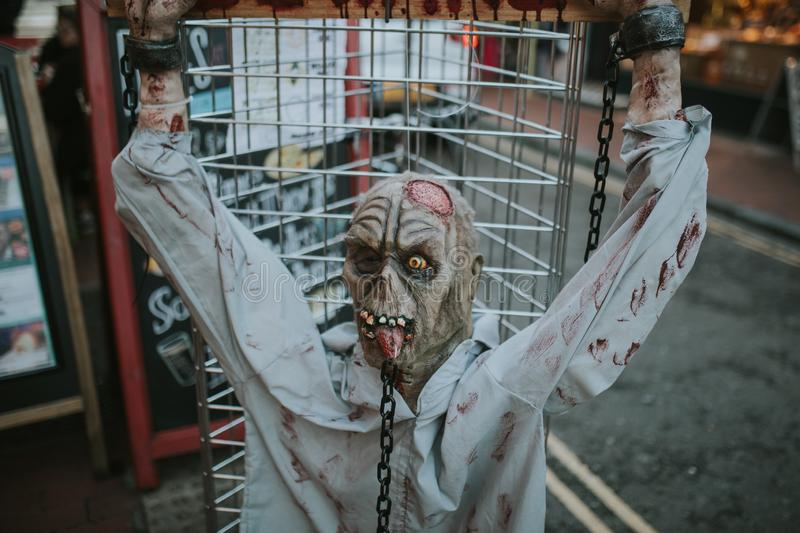 Halloween zombie spiked in a fence. royalty free stock image