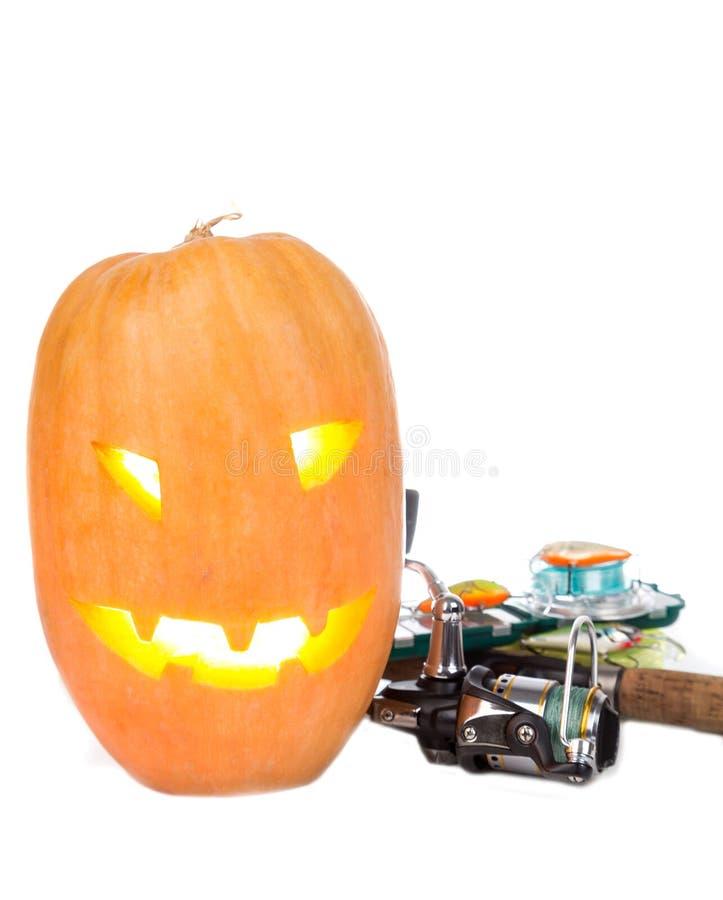 Halloweenowa bania z połowów sprzętami na bielu fotografia stock