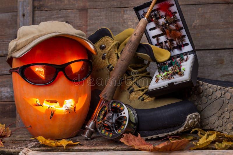 Halloweenowa bania z watować buty i połów obrazy royalty free