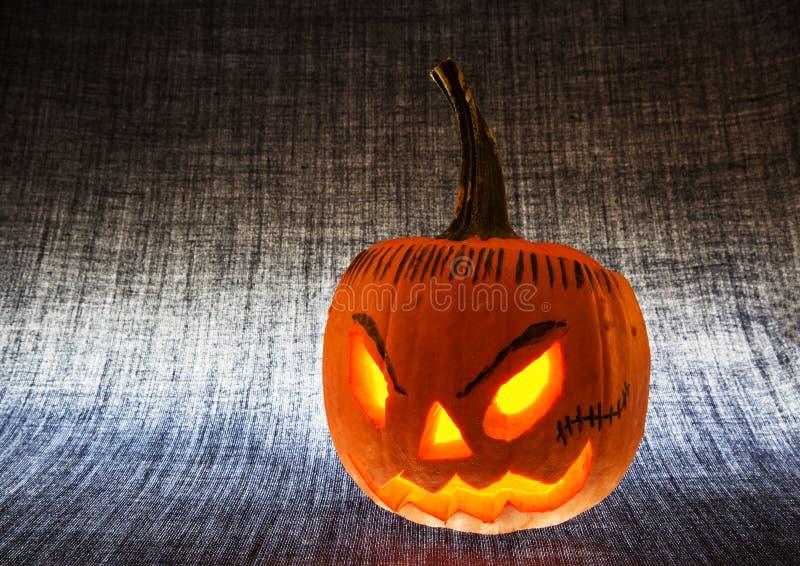 Halloweenowa bania zaświecająca spod spodu horyzontalny fotografia royalty free