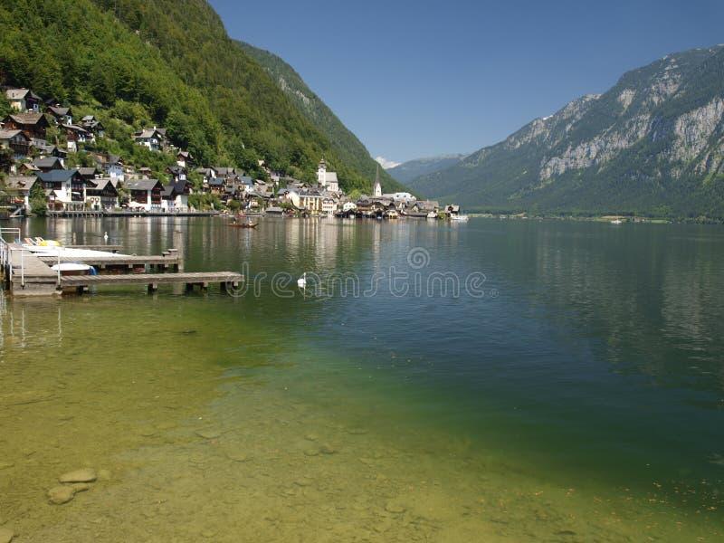 Hallstadt in austria over lake in alps. stock image