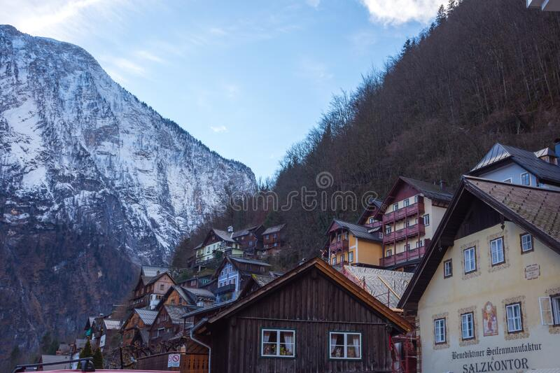 Hallstatt/Austria- December 26, 2019: Colorful little houses on the hill in Hallstatt, a charming traditional village and a famous. Tourist attraction in royalty free stock photos