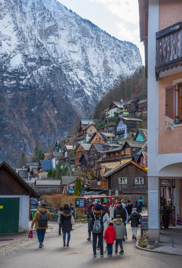 Hallstatt/Austria- December 26, 2019: Colorful little houses on the hill in Hallstatt, a charming traditional village and a famous. Tourist attraction in stock photography