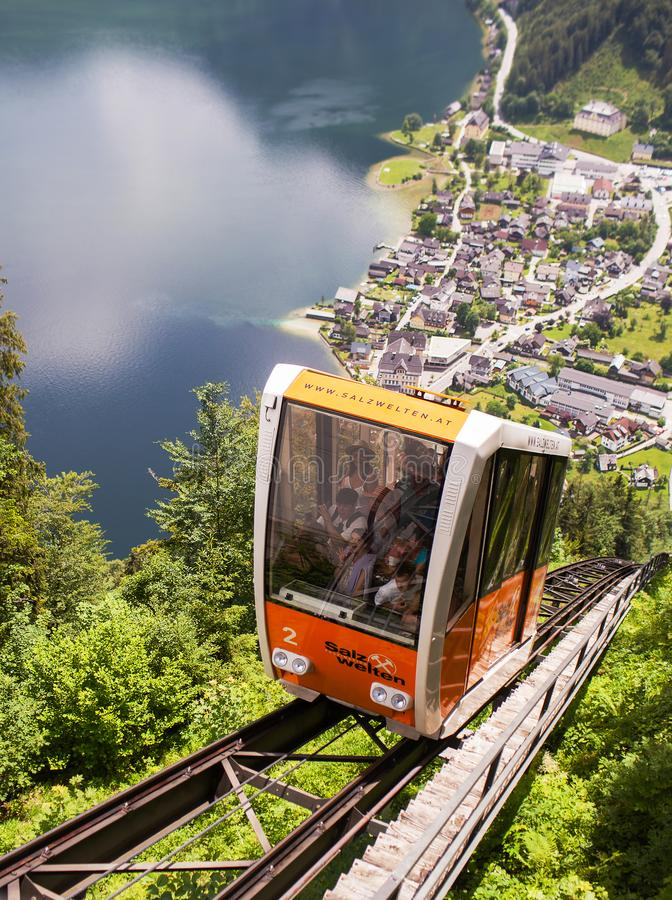Hallstatt, Austria - May 31, 2018: Funicular climbs up the railway royalty free stock images