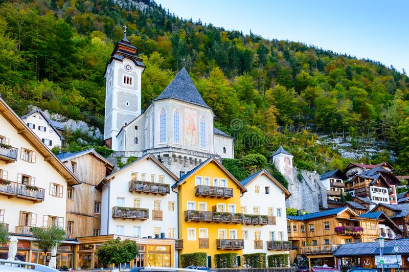 Hallstatt, Austria. Popular town with colorful historic houses and church in Austrian Alps mountains. Hallstatt, Austria. Picturesque alpine town with colorful royalty free stock images