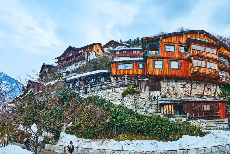 Hallstatt hus på berglutningen, Salzkammergut, Österrike royaltyfri foto