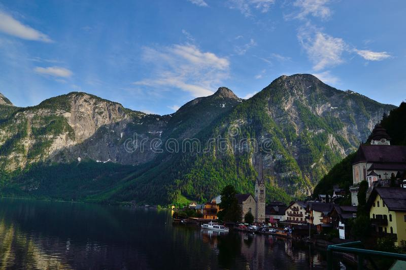 Hallstatt lake mountain. The community at Hallstatt exploited the salt mines in the area, which had been worked from time to time since the Neolithic royalty free stock images