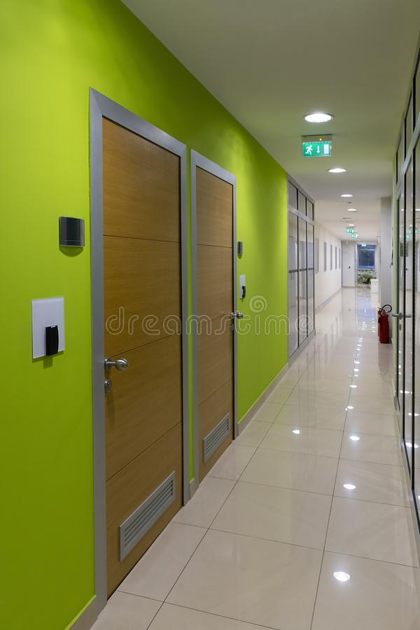 Hallway of business building with offices. Modern Hallway of business building with offices and walls in lime color royalty free stock photo