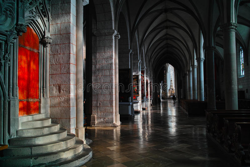 Hallway in cathedral of Augsburg. Sunlight shining into the long hallway of the Cathedral of Augsburg in Germany - a roman catholic church founded in the 11th stock image