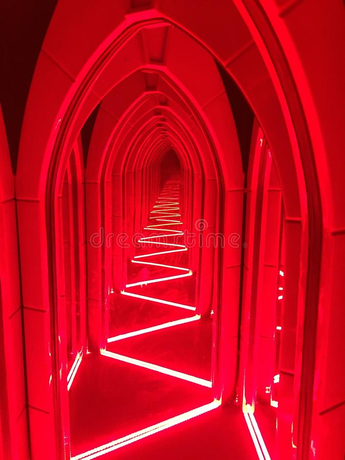A hallway lit with bright red light. A hallway in glass house in Mysore, life with red light and bright neon lights royalty free stock images