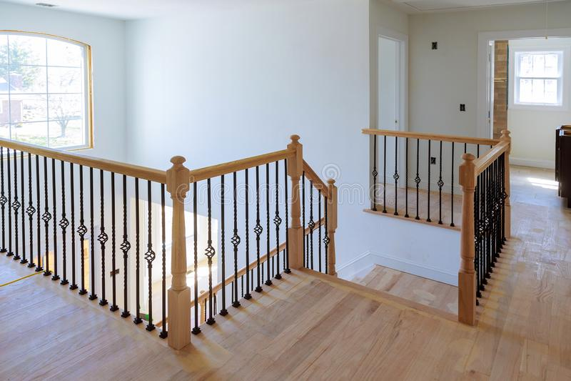 Hallway interior with hardwood floor. View of wooden stairs stock photos