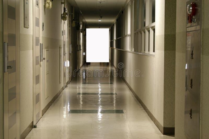 Hallway leads to blank wall stock photo