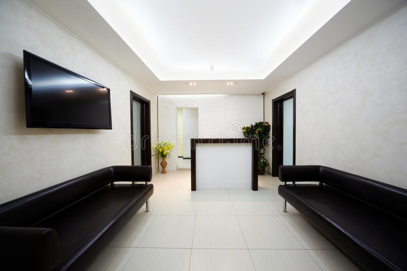Hallway in salon with leather divans