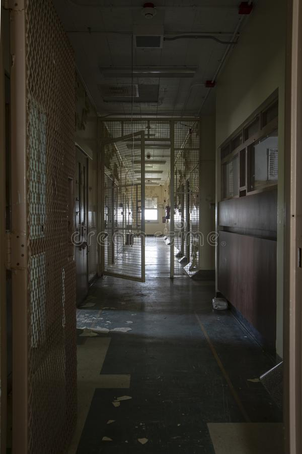 Hallway with solitary confinement cells in prison hospital royalty free stock image