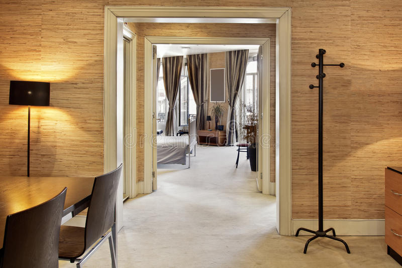 Hallway. Spacious Hallway with carpeting and cork walls royalty free stock image