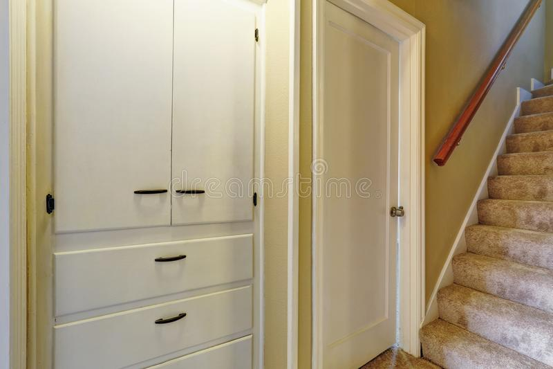 Detail Of Hallway Interior With Carpet Stairs And White Built In Cabinets.  Northwest, USA