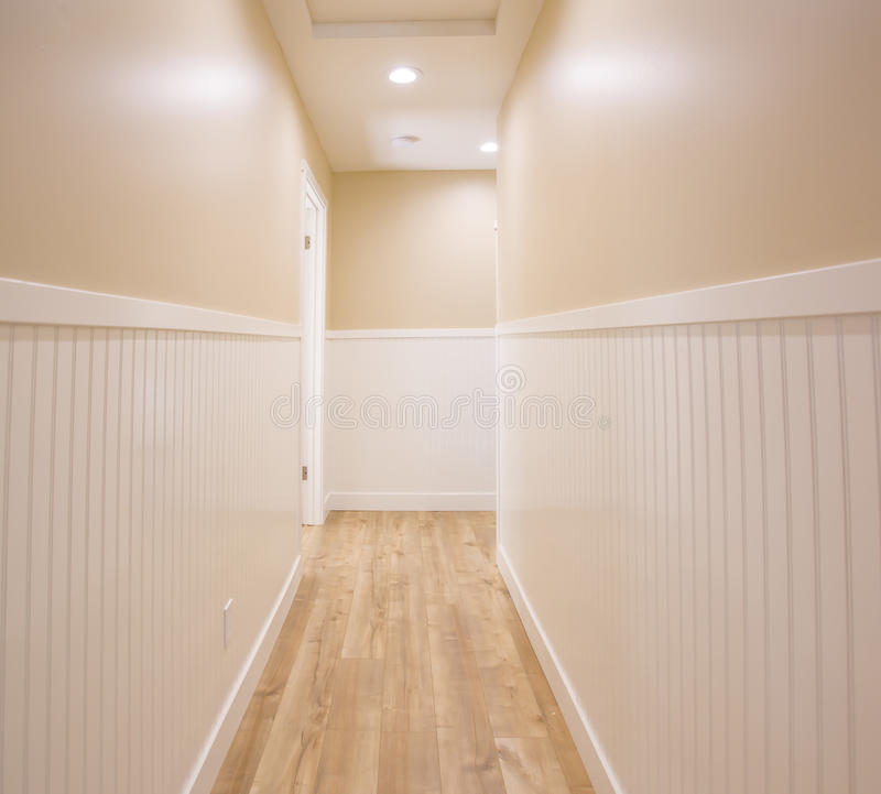 Hallway with wooden floors. Empty Hallway in a Southern California home ready to be listed for real estate stock photography