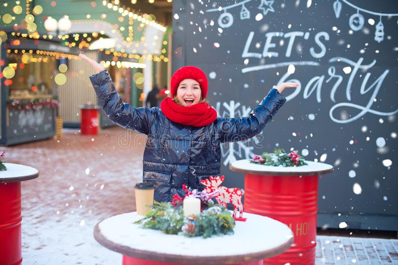 Hally european teenage girl laugh and drop snowflakes in air. Model is on christmas fair. Happy holidays. Hally european teenage girl laugh and drop snowflakes royalty free stock images