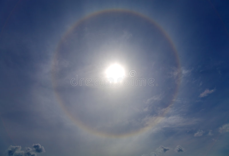 Halo around of the sun. Circles halo in the blue sky around of the sun stock photography