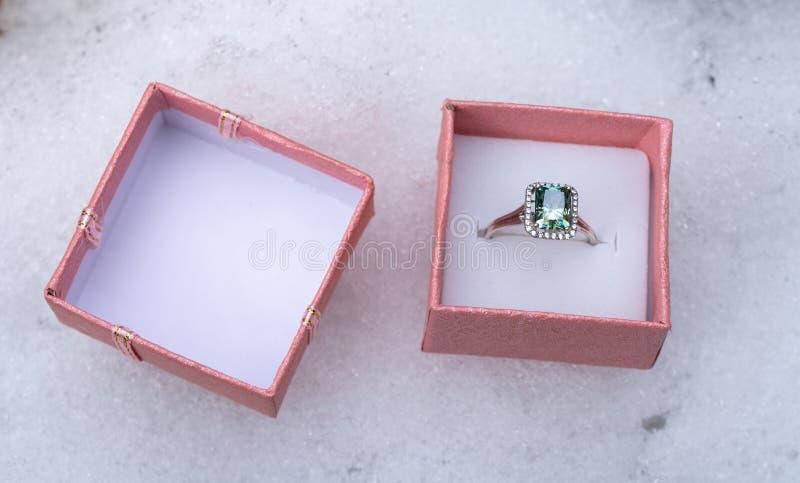 Emerald Engagement Halo Ring royalty free stock photo