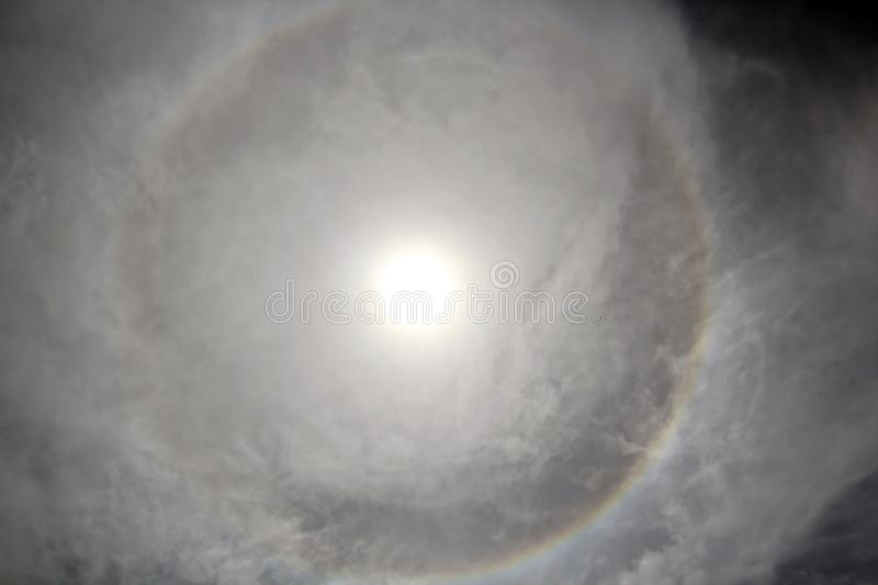 The halo is a circle around the sun as a rare natural phenomenon in the sky. The precursors of the weather change are the appearance of a halo around the sun stock photos