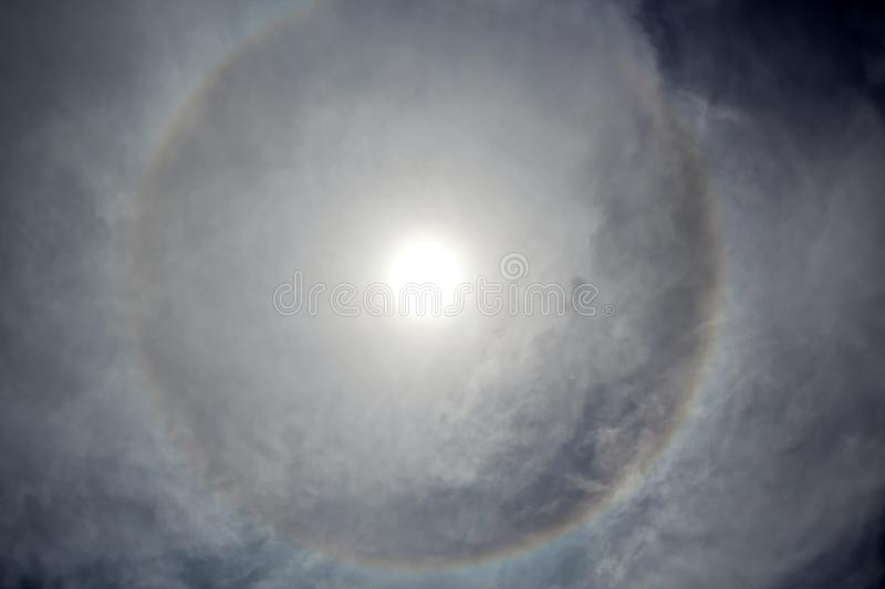 The halo is a circle around the sun as a rare natural phenomenon in the sky. The precursors of the weather change are the appearance of a halo around the sun royalty free stock photos