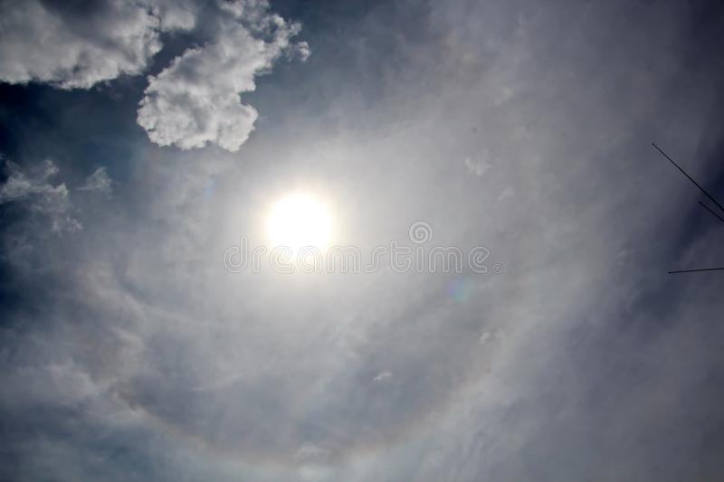 The halo is a circle around the sun as a rare natural phenomenon in the sky. The precursors of the weather change are the appearance of a halo around the sun royalty free stock photo