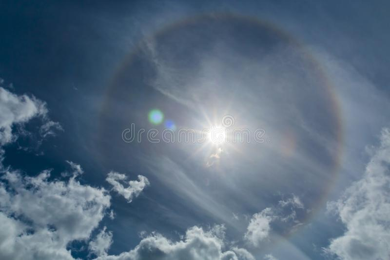 Halo Phenomena In The Sky. Halos are atmospheric phenomena created by light which is reflected or refracted by ice crystals in the atmosphere. Halos can have stock images
