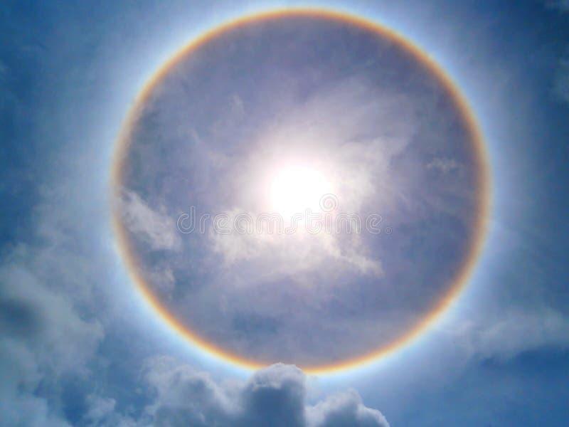 Halo phenomenon. Sunlight, brightsk, brightsky, circular, clouds, rainbow, rings, bluesky royalty free stock image