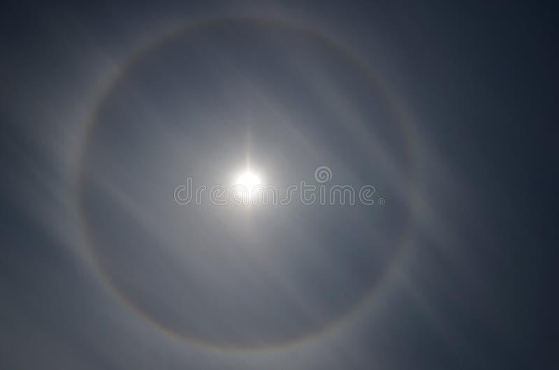 Halo, ring around sun stock photo
