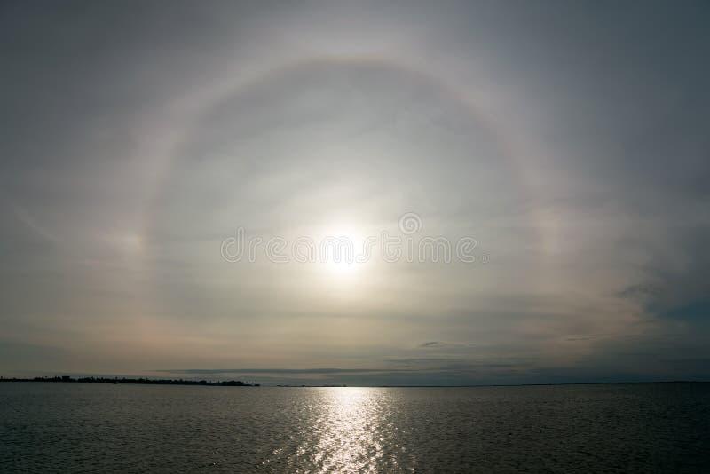 Halo Solar, optical phenomenon and sun path to the sea. Texas, t. He Gulf of Mexico, USA royalty free stock photos