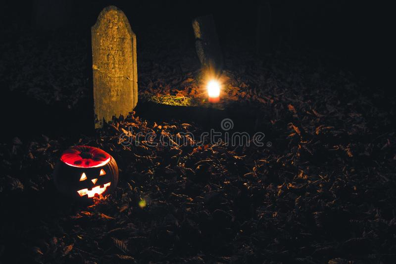 Haloween on the cemetry. Haloween pumpkin on the cemetry in the night royalty free stock images