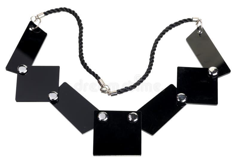 Halsband av svarta plana plattor som isoleras royaltyfria foton